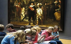 Source: http://www.telegraph.co.uk/news/newstopics/howaboutthat/12103150/Rembrandt-The-Night-Watch-The-real-story-behind-the-kids-on-phones-photo.html